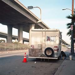 Marooned (ADMurr) Tags: la southla camper rv orange cone freeway sign palm rollei planar kodak ektar rolleiflex