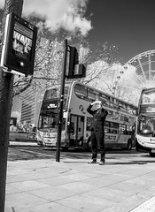 Where did you say the bus stop is? (tootdood) Tags: blackandwhite bus mobile manchester phone cell piccadilly stop fromthehip iseenoships streetcandid canon70d