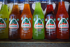"""Jarritos"" (Eric Flexyourhead (shoulder injury, slow)) Tags: city red urban orange usa detail green glass oregon portland strawberry downtown bottles drink vibrant beverage vivid mexican pineapple mango repetition mandarin pdx soda colourful lime ricohgr softdrink jarritos fragment tamarind stumptown foodcart rosecity multnomahcounty"