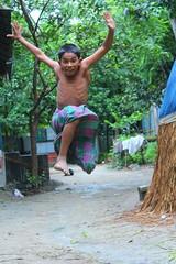 kung fu jump (sabbir ahmed abeir) Tags: green beautiful canon children jump village child bokeh outdoor candid explore fantasy enjoy kungfu childish bangladeshi explored explorebangladesh