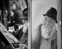 Mirror Image (James- Burke) Tags: artists beards blackandwhite candid drawing france mirrorimage newspapers painters painting parismontmarte peaceful reading relaxation relaxing sittingrelaxing skill street tourism work bw