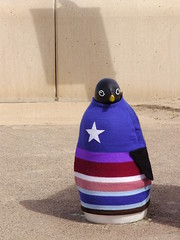 Captain Penguin (Nekoglyph) Tags: blue summer cute wool wall concrete star penguin seaside shadows cleveland promenade jumper publicart knitted seafront captainamerica teesside striped redcar seadefences yarnbombing
