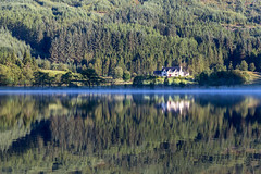 Loch Chon (dalejckelly) Tags: canon loch chon trossachs scotland lake reflection reflections landscape water mist trees forest house