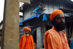 Two holy men and the Spiderman (Rajib Singha) Tags: travel street people art outdoor orange portrait documentary record moment interestingness flickriver nikond200 mfnikkor20mmf35aislens kumartuli kolkata westbengal india spiderman