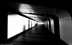 Inter Dimensional Shift - King's Cross Walkway (On Explore 14th Apr 2015) (Simon & His Camera) Tags: city light people urban blackandwhite bw white black london monochrome lines architecture night contrast dark underground lights hall corridor surreal tunnel explore serene passage iconic vignette 52weeks simonandhiscamera