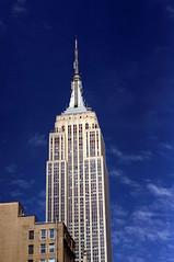 Empire State Building, polarized 2 (aaronvandorn) Tags: newyorkcity spring bluesky study empirestatebuilding digitalcamera darksky whiteclouds polarizedfilter rokkor50mmf17 manualprime sonynex6