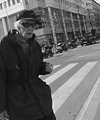 Old man crossing (Eric_G73) Tags: street old people sunglasses walking crossing cigarette candid streetphotography streetlife oldman cap elderly walkingby candidphotography stolenmoment walkbyshooting