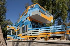 orange architecturehouse modernhousemodernmodernhomehillsidesustainablerecycledmaterialslosangelesglassellparkgreenmoderndesignmodernarchitectureclerestorywindowspassivecoolingpassivedaylightingsolarenergygreywaterrecyclingrainwatercollection