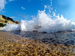Crashing wave on shore of beach in Cassis, France (allisonrubin) Tags: ocean france beach sand europe cassis crashingwave gopro cassisfrance