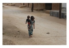 tender loving care (handheld-films) Tags: street travel family india children togetherness support indian young documentary siblings villages responsibility care closeness isolated subcontinent sisterandbrother ruralindia fleshandblood