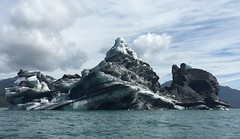 Iceberg Columbia Glacier Prince William Sound Alaska USA (eriagn) Tags: iceberg columbiaglacier princewilliamsound alaska usa summer melting eroded shape ice silt dirt sea tidal kayak recreation eriagn ngairehart travel adventure water cold formation photography retreating receding cloudy overcast panorama