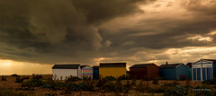 Beach huts and rain coming (Peter H 01) Tags: rain clouds evening outdoor haylingisland beachhuts