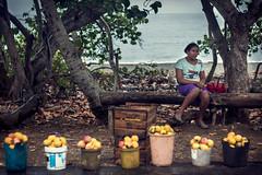Selling mangoes (Audiovisual project) Tags: mangos mangoes yumur cuba yumurcuba candelyumur yumurbaracoa yumurbaracoacuba baracoa baracoacuba tropical mar caribe caribbean cuban cubains women cubawomen woman girl lady cubanlady rainy rain rainyday water beach tropicalbeach cubanbeach travelphotography