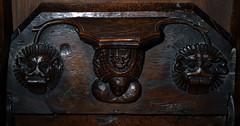 Minster in Thanet, Kent, St. Mary's church, choir, stalls, north side, misericord # 6 (groenling) Tags: minster thanet kent england britain greatbritain gb uk stmaryschurch stalls misericord wood carving woodcarving woman headdress hennin devil supporter face tongue grotesque