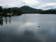 Solitary boat (pilechko) Tags: mirrorlake lakeplacid water lake boat mountains reflections dusk evening light clouds