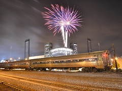 Fireworks and trains (Robby Gragg) Tags: field silver coach cross fireworks amtrak joliet