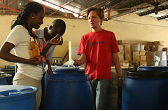 The Production Manager of MAGNUM Industries of Kicukiro in Rwanda Capital Kigali, showing chemical products to use in making shampoo,July 21 2016 (mamenriet) Tags: magnumn industries chemical products kicukiro shampoo kevi