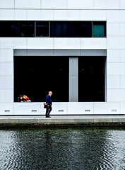 Passing strangers... (kevingrieve610) Tags: river canal paddington basin london city people water waterfront depth fujifilm wow flickr