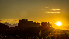 Bamburgh castle sunset (tattie62) Tags: bamburgh northumberland england castle evening bamburghcastle silhouette shadows golden light sun fortress stronghold
