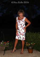 Floral Fun (Miss Kellie Keene) Tags: beautiful brunette silver jewelry anklet earrings toering silky smooth tan bare legs pretty polished purple nails floral print wiggle dress sexy strappy highheel sandals lovely elegant stylish transgender woman misskellie