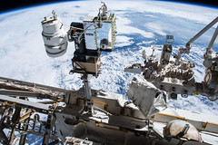 iss048e069605 (NASA Johnson) Tags: spacewalk eva extravehicularmobilityunit extravehicularactivity jeff williams kate rubins nasa astronaut external earth feet robotics cameras solar array