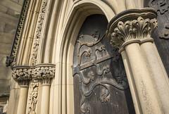 Ornate doorway, Bakewell Church (Keartona) Tags: door england detail architecture carved arch stonework derbyshire peakdistrict columns sunny doorway ornate bakewell hinges allsaintschurch