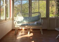 une vranda au soleil (S amo) Tags: light switzerland suisse veranda sofa lumiere porch verandah cushion rattan neuchtel fenetre canap coussin saintclaude rotin stclaude