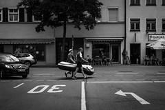 200/366 - Nebeneinanderstellungen / Juxtapositions (Boris Thaser) Tags: 29nebeneinanderstellungen 365 366 32 creativecommons deutschland erwachsener explore flanieren flickr gehen germany gummiboot juxtaposition mann menschen nabada nebeneinanderstellung project365 projekt querformat sw schlauchboot schlendern schwarzweis sommer sonydscrx100ii sonyrx100ii spazieren stadt strase strasenfotografie streetphotography szene ulm adult bw blackandwhite boat candid city landscapeformat man people photoaday pictureaday project project366 rubberboat scene street streettog strolling summer tog ungestellt unposed walking zweisichtde zweisichtig
