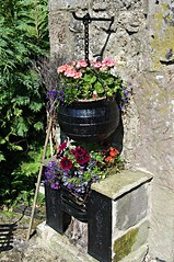 Flowers everywhere (Blue sky and countryside.) Tags: flowers old cooking pot fire place limestone building pretty attractive display garden derbyshire winster village peak district national park england summertime pentax