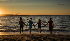 Loving Life (jeanmarie shelton) Tags: jeanmarieshelton jeanmarie beach shore waterscape landscape water ocean serene sunset tide colors children kids friendship sky clouds