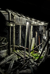 what remains (Mike Fritcher) Tags: lumber moss forgotten wood light fallingtopieces barn illumination abandoned whatremains art architecture americana abandonedbuildings alone abandon dark decay hardtimes isolation mikefritcher michigan nikon northernmichigan old peaceful puremichigan poverty poor rural ruraldecline scenic serene sad vintage victimofcircumstance weather sun sunray