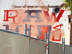 Raw Hide (Harvey Schiller - chateauglenunga) Tags: city urban building sign wall fence painting raw afternoon painted demolition hide font adelaide barrier rawhide