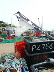 waiting for a ferry (bgiebabe) Tags: harbour flag boxes ropes torquay nets buoys