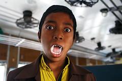 Vampire boy - Dhaka, Bangladesh (Maciej Dakowicz) Tags: bangladesh dhaka city kamlapur kamalapur railway station train passenger portrait boy vampire teeth