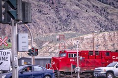 CP 9357 (robinlamb1) Tags: trains railroad railway cp9357 ge es44ac westbound kamloops bc outdoors mountains traffic cars trafficlight