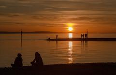 Relaxing (olijaeger) Tags: sunset shadow sky people orange cloud lake seascape black reflection clouds canon reflections landscape sonnenuntergang bodensee schatten badenwürttemberg langenargen argenmündung 5dmkiii canon5dmarkiii
