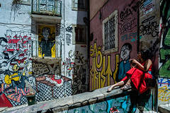 Blended in street art 0716006 (meriwaniart) Tags: young lady red blended within street art lisbon portugal july 2016 meriwani photographs