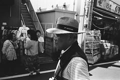 Yanaka, Tokyo (fabiolug) Tags: man hat light shadow yanaka people street streetphotography tokyo japan japanese asia leicamp leica mp rangefinder film filmphotography believeinfilm blackandwhite blackwhite bw kodaktrix400 trix400 kodak trix kodaktrix leicaelmarit28mmf28asph elmarit28mmf28asph elmarit28mm leicaelmarit28mm 28mm elmarit leicaelmarit wide wideangle