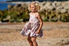Summer Girl (karenmarquick) Tags: summer august highcliffe beach dorset seaside child fun happy smiles jumping dress swirling twirling movement fluid