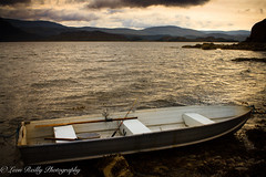Boat on Loch Torridon (broadswordcallingdannyboy) Tags: scotland northwesthighlands holiday eos7d highlands torridon lightroom4 canonlens inveralligin light dusk evening magichour water loch landscape dramaticsky beautifullight longlight scottishlandscape scottishsummer scottishscenes scottishscenery copyrightleonreillyphotography canon mood atmosphere dreamscape moody boat waterside fishingboat lowlight sunset leonreilly