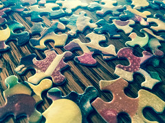 Puzzle Pieces (Steven Green Photography) Tags: activity contemporary game hobby indooractivities pastime puzzle puzzlepieces rainyday table toy woodgrain