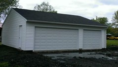 32' X 24' Reverse Gable with 1- 16' X 7' and 1- 9' X 7' Overhead Door