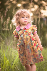 Childhood... (Marla Nutbrown) Tags: sunset girl grass childhood children dress little sunflowers naturallightphotography marlanutbrownphotography