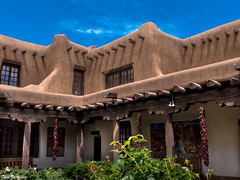 New Mexico Museum of Art (Thad Zajdowicz) Tags: architecture building adobe southwestern americanwest newmexicomusuemofart courtyard santafe newmexico zajdowicz leica lightroom availablelight daylight color sky clouds blue green brown outdoor outside travel