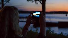 Picture in picture (fredrik.gattan) Tags: sunset summer woman girl mobile night landscape cityscape phone waterfront sweden stockholm picture screen hornsberg hornsbergsstrand