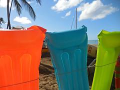 colors (kenjet) Tags: beach colors hawaii pretty waikiki oahu tropical raft choices waikikibeach floaties floats blowup rafts