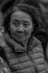 ADF_20140303_1083 (chiyowolf) Tags: chengdu sichuanprovince streetscenes facesofchengdu peopleofchengdu candidphotography canoneos7d downjacket chinesewoman wrinkledforehead  travelphotography