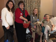 Terri, Wanda, and Laura visit with a nursing home resident to spread Good Vibes for Valentine's Day.