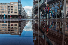 Shopping center reflections @ Zeist (PaulHoo) Tags: zeist holland netherlands 2016 summer city urban citylife people candid streetcandid streetphotography architecture buildings puddle water mirror reflection cycling bike shoppingcenter