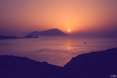 Aegean sunset (kana movana) Tags: sunset summer sea seaside milos island greece greek aegean mediterranean mediterraneo reflection reflex relax relaxing sun hill cliff ship sailboat boat d90 landscape outdoor